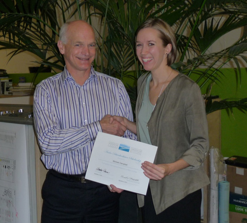LACF board member Peter Kreuk, FCSLA, presents the 2012 Schwabenbauer award to Michele Cambell, MLA student at UBC.